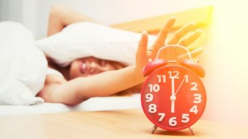 girl-turning-off-the-alarm-clock_1150-184